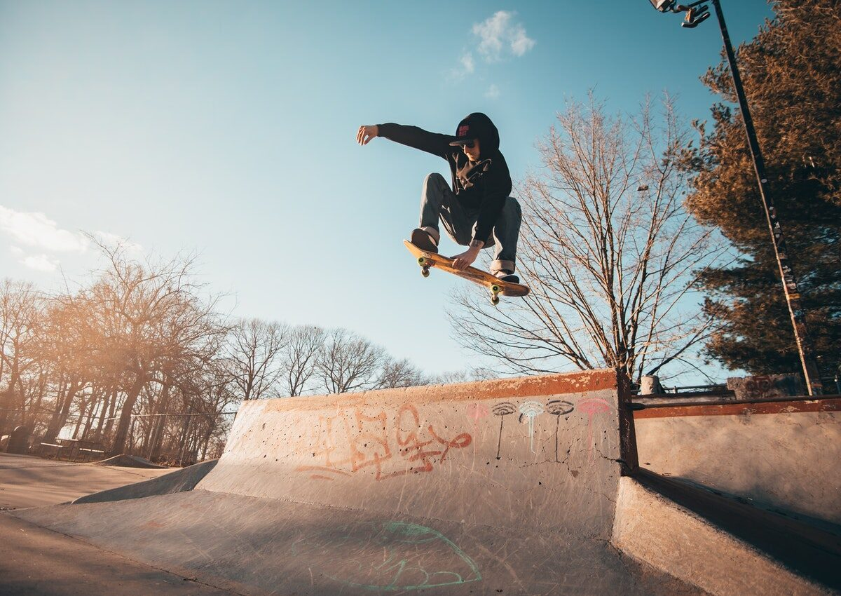 Photography of Man Doing A Skateboard Trick